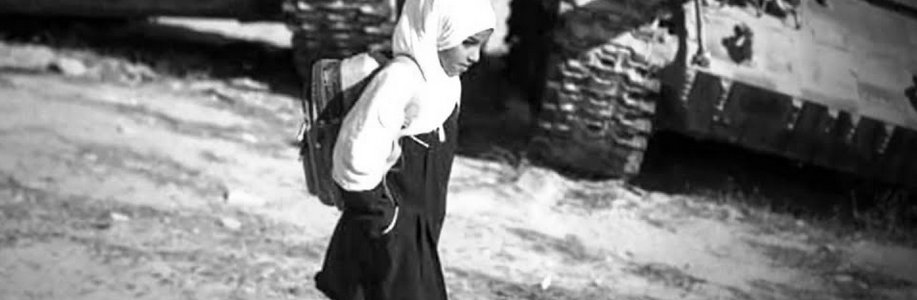 Photo of schoolgirl walking through a conflict zone